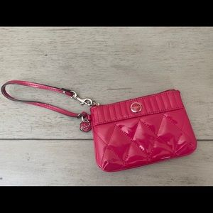 Coach hot pink patent leather wristlet.
